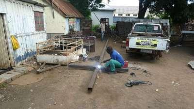 Welder Preparing Cross Beams