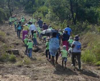 The Kids Head Up Fire Mountain For Cross Planting