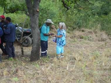 Pastor Carol Hands Out ccm Cross Builder Bracelets To Each Worker