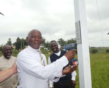 Pastor Qupuna Declaring Gods Glory By Attaching Plaque