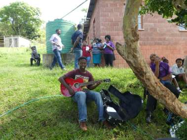 Here The Older Guitar Picker Is Mentoring The Younger Students In Worship