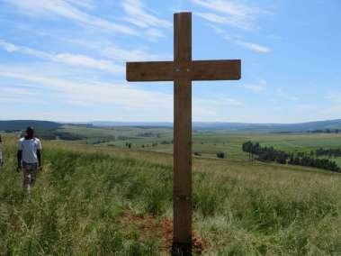 Cross Overlooking Farm Land