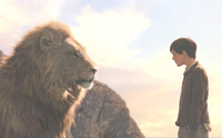 Aslan has a private word with Edmund (Skandar Keynes) after rescuing him from the Witch