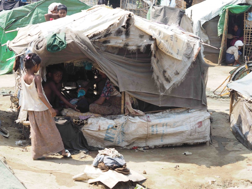 Rohingya family in their makeshift housing in an IDP camp - Sittwe. Photo courtesy Partners Relief and Development.