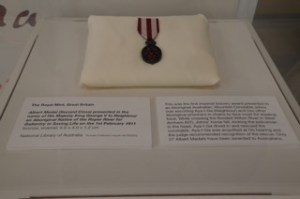 Military medal, history in Darwin Parliament building
