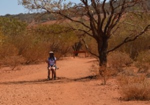 Christie Adams sat in shade of Australian outback