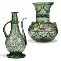 A GILT AND ENAMELLED CLEAR GLASS MOSQUE LAMP AND A EWER ...
