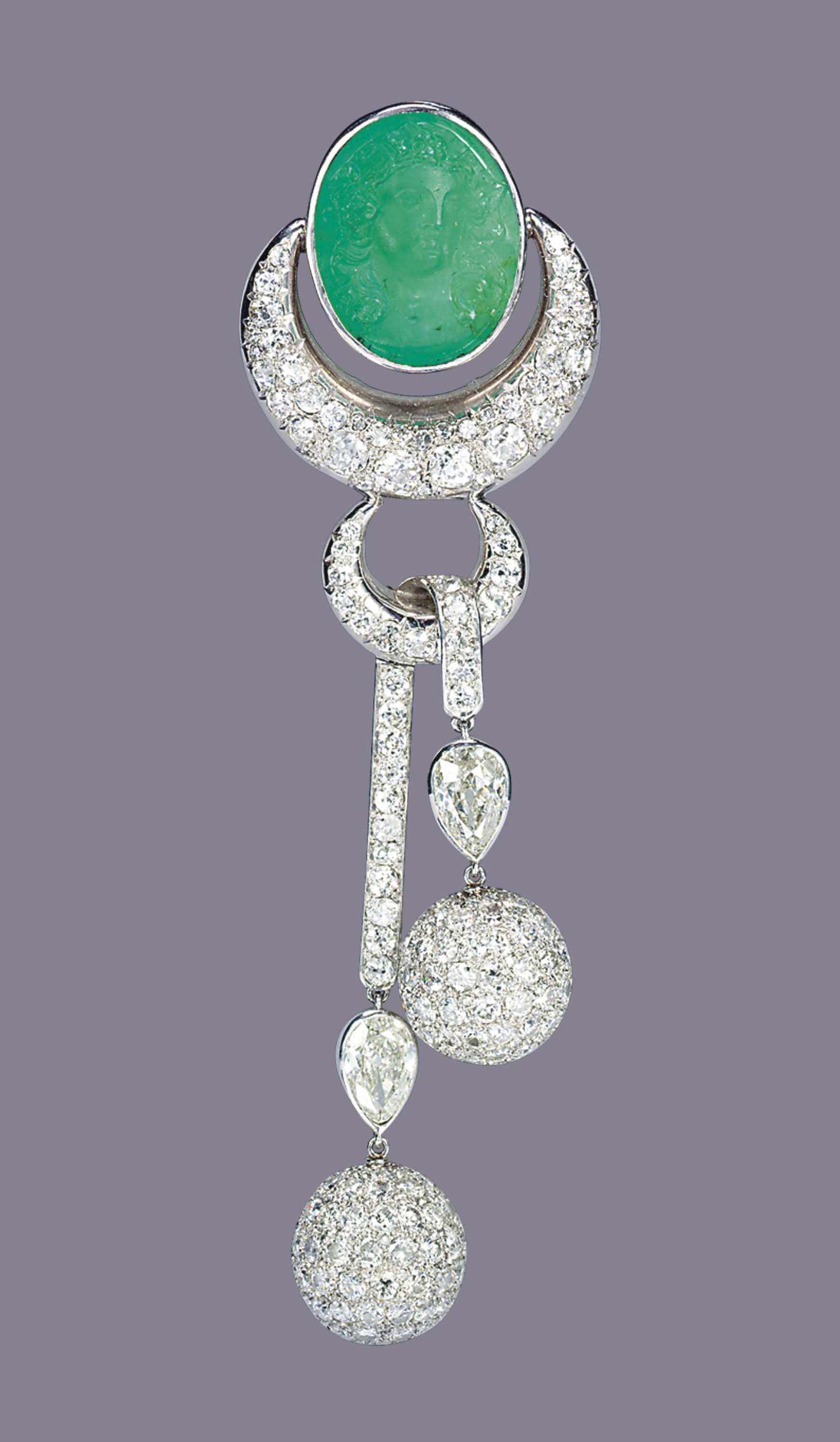 AN EMERALD AND DIAMOND BROOCH, BY SUZANNE BELPERRON