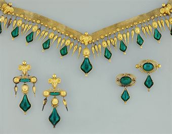 A 19th century archaeological revival gold and green paste parure