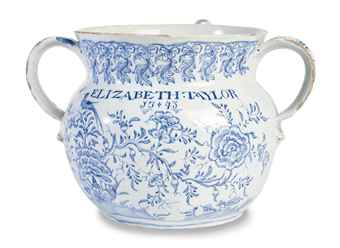 Lot 879: A Bristol Delft Named and Dated Posset Pot, Dated 1743. Estimated price: $8,000 - 12,000