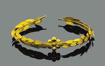 An archaeological revival gold head ornament, by Castellani