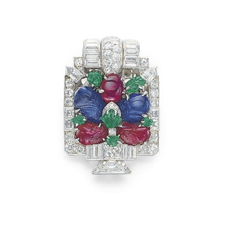 AN ART DECO DIAMOND, RUBY, SAPPHIRE AND EMERALD TUTTI FRUTTI DRESS CLIP, BY CARTIER