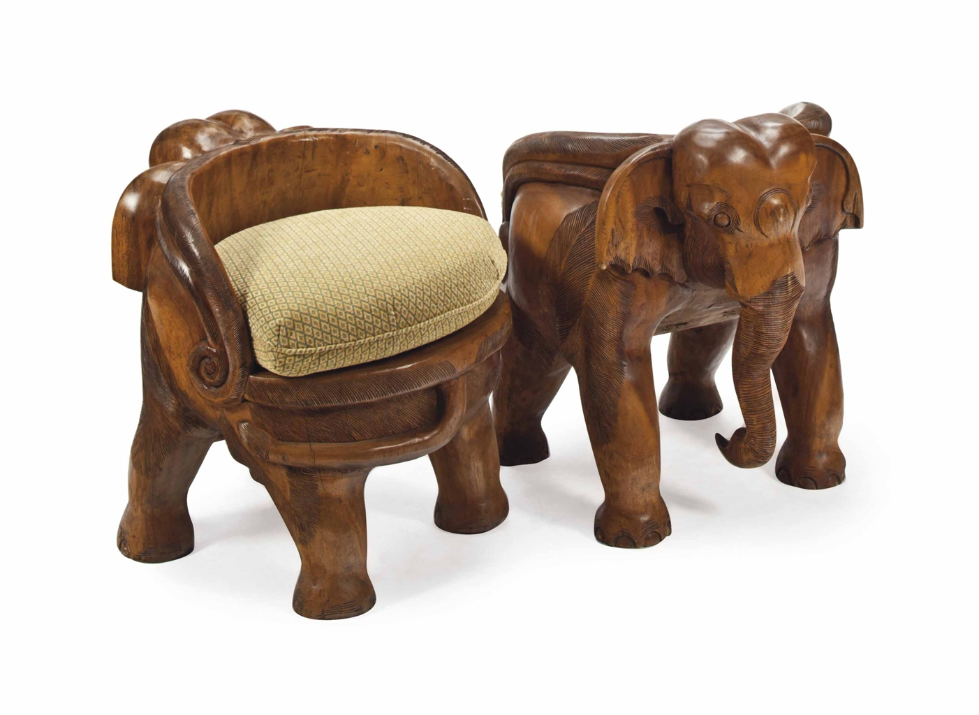 A PAIR OF CARVED HARDWOOD ELEPHANTFORM SMALL CHAIRS