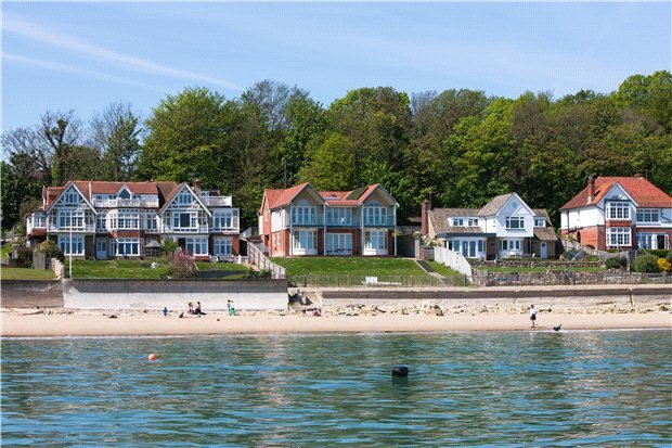 5 Bedrooms, 2,699 sq. ft.A spectacular seafront home, built in 2009 to maximize its glorious Solent views within the sought-after and tranquil Seagrove Bay. A huge ground floor family room provides an ideal open space for family time, to socialize and relax together. Large bay picture windows with fitted seating and double doors opening on to a large elevate terrace and onto the lawned gardens from which the ever-changing views across The Solent can be appreciated from direct access onto the beach. The first floor boasts four well fitted light and generous double bedrooms (three of which are en suite).