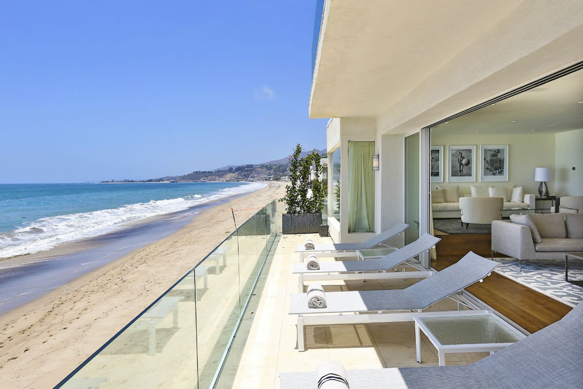 This modern Malibu beach oasis has a rare location on 60 feet of prestigious Carbon Beach frontage. World-renowned interior designer Trip Hanisch transformed the property into an oceanfront paradise with lavish interior spaces and massive beach-side decks, offering sensational sunset vistas throughout.