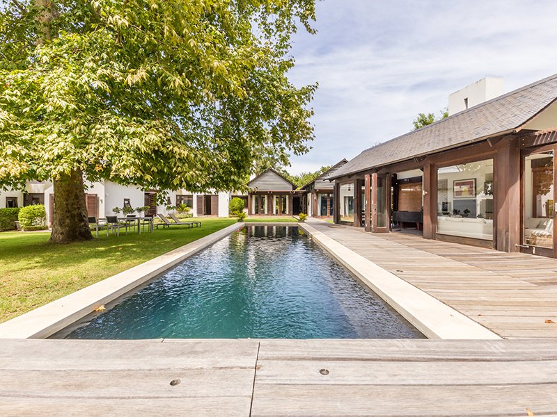 This spectacular five-bed home is located on the Cape Peninsula, where many of Cape Town's finest wineries are also located.