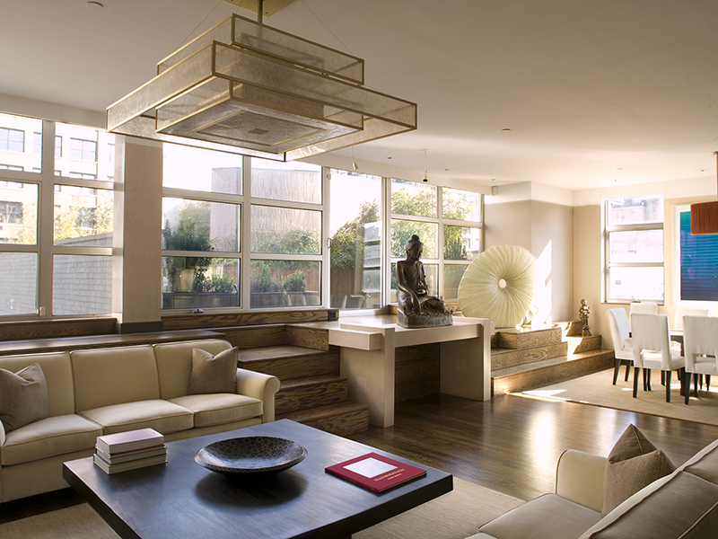 Living and dining room with buddha statue