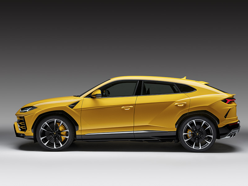 Side view of Lamborghini Urus SUV in bright yellow