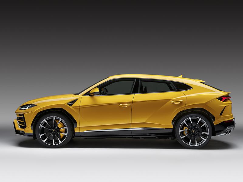 Side view of Lamborghini Urus SUV in bright yellow