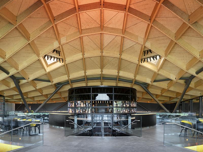 Bar in wood-ceilinged distillery