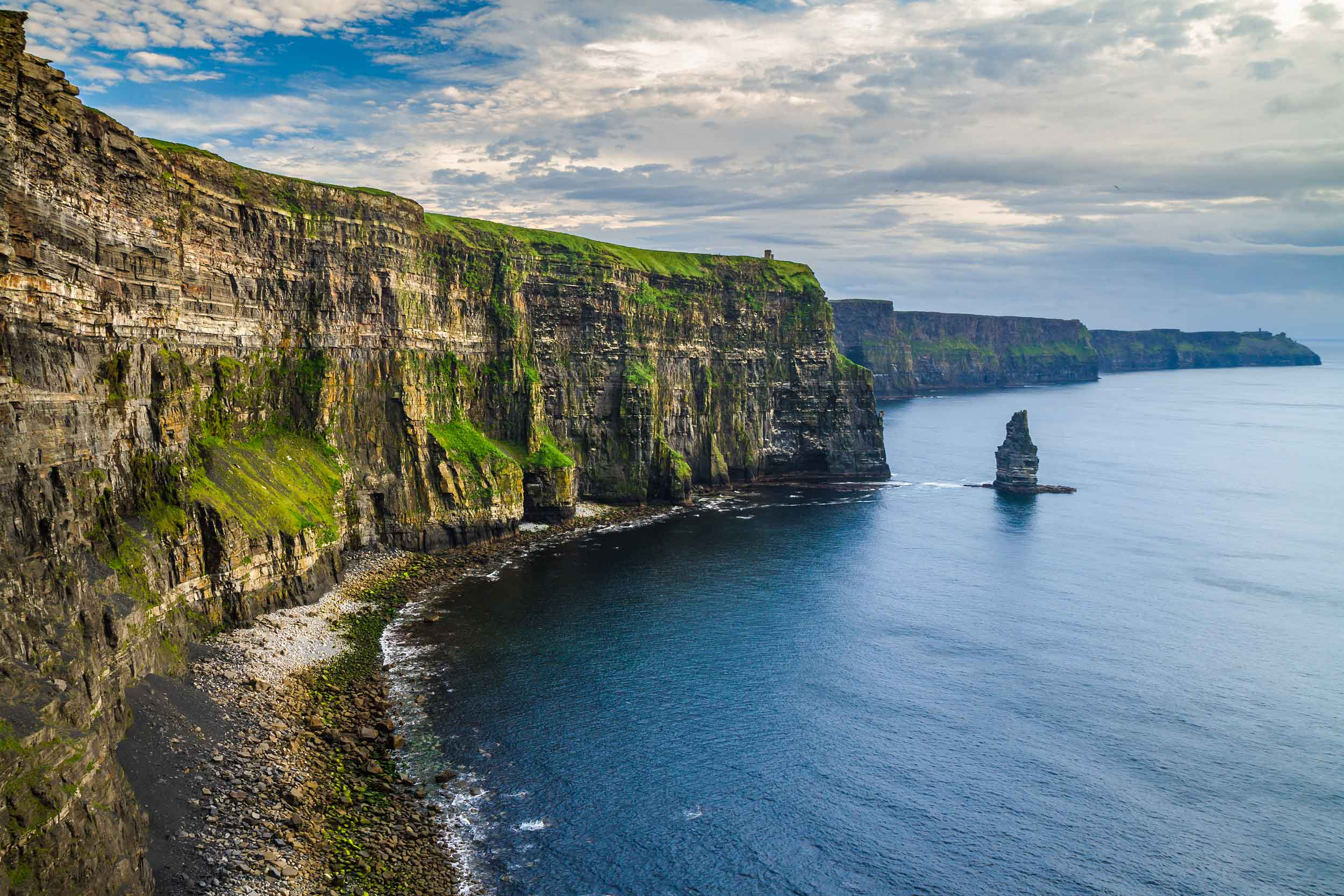 The rugged beauty of Ireland's western coastline is best seen from the famed Cliffs of Moher, a UNESCO Global Geopark and one of the natural wonders of Ireland's Wild Atlantic Way, the world's longest coastal touring route.
