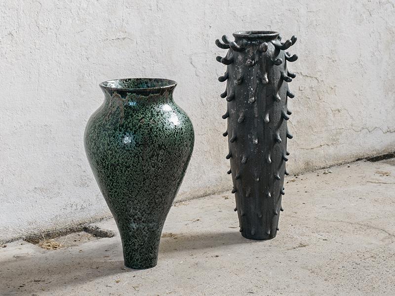 Two vases on concrete floor