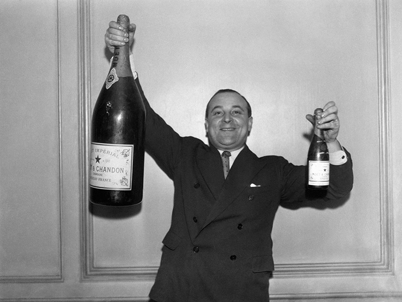 man-holding-large-bottle-of-red-wine-Gettyimages