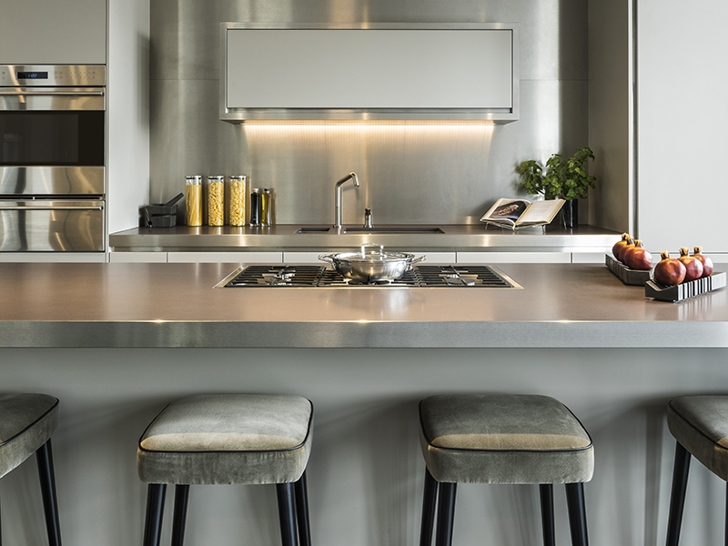 Stainless steel counters in a kitchen designed by Millier interiors