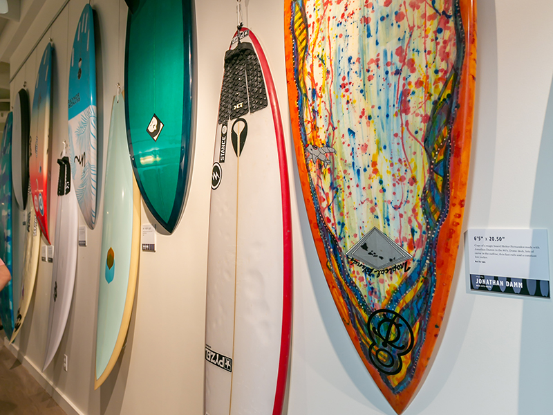 A row of surfboards on display