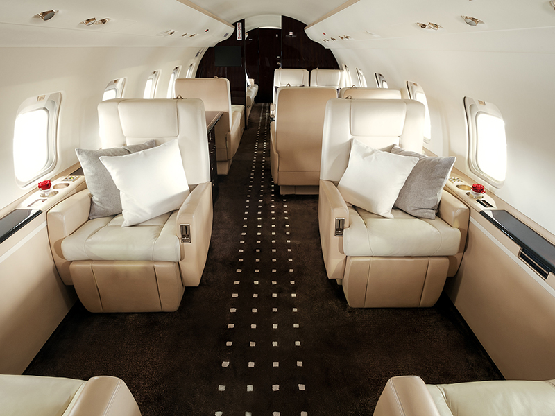 The interior of VistaJets Challenger plane is ideal to fly private