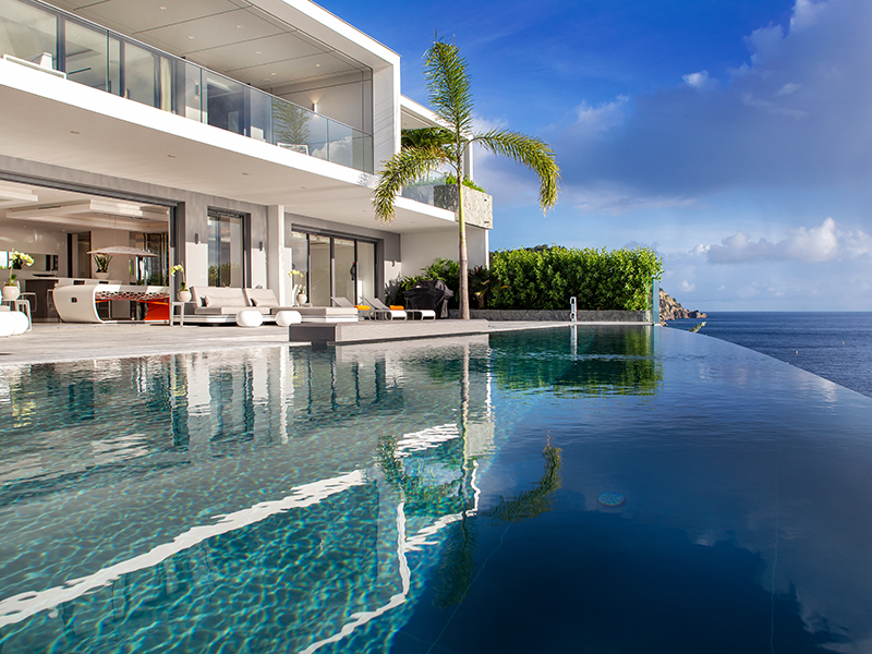 The view over the infinity pool and ocean at Eden Rock's Villa Axel Rocks