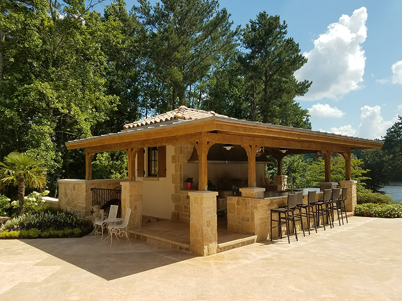 Covered outdoor kitchen with bar