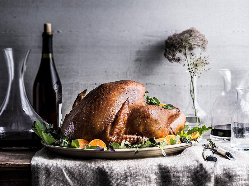 Turkey set on a table with a carafe of red wine