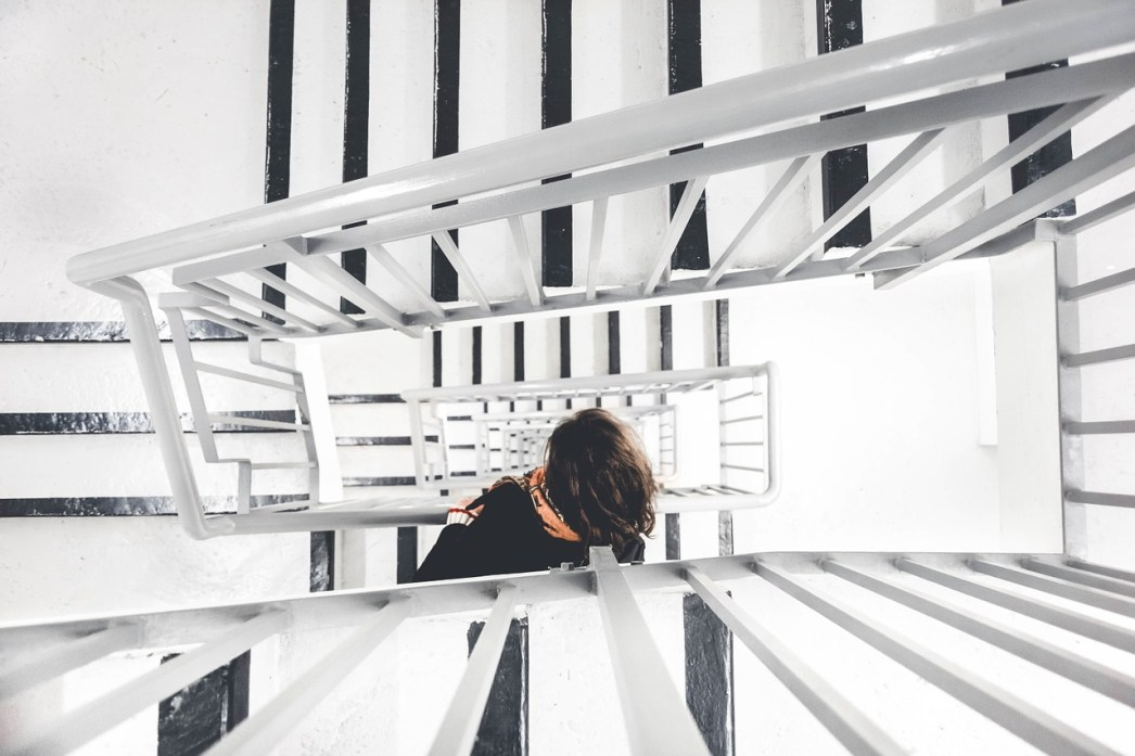 striving up the endless stair of needs