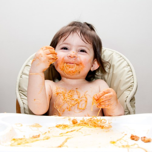baby using her senses to eat!