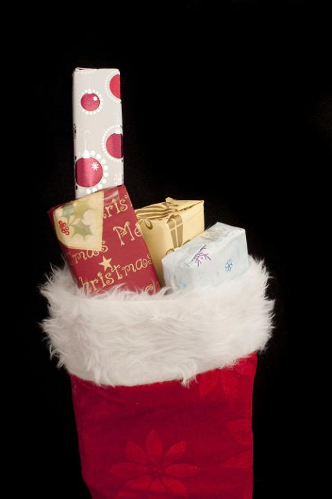 Photo Of Small Christmas Gifts Filling A Red Stocking Free Christmas Images