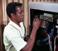 """Barney Collier (Greg Morris) works to unfix an election in """"Wheels"""""""