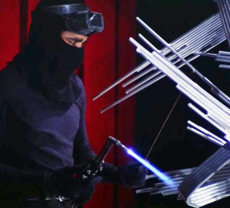 "Barney (Greg Morris) liberates a top secret alloy from a metal sculpture in ""The Phoenix"""