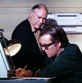 "The villains of ""The Photographer,"" Anthony Zerbe and John Randolph, decipher a coded transmission"