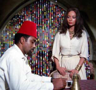 "Barney (Greg Morris) approaches Atheda (Arlene Martel) in order to infiltrate a terrorist cell in ""Terror"""