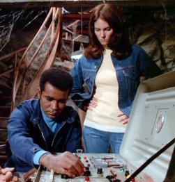 """Barney (Greg Morris) and Dana (Lesley Warren) spook the villains from an abandoned bomb shelter in """"A Ghost Story"""""""
