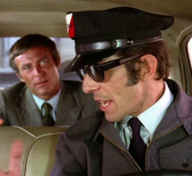 "Impatient assassin Eddie Lorca (Robert Conrad) argues with cab driver Paris (Leonard Nimoy) in ""The Killer"""