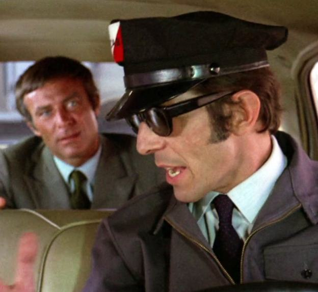 "Impatient assassin Eddie Lorca (Robert Conrad) argues with cab driver Paris (Leonard Nimoy) in ""The Killer"""