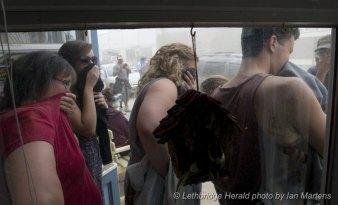 Des habitants de Lethbridge pendant la fausse tempête du tournage d'Interstellar