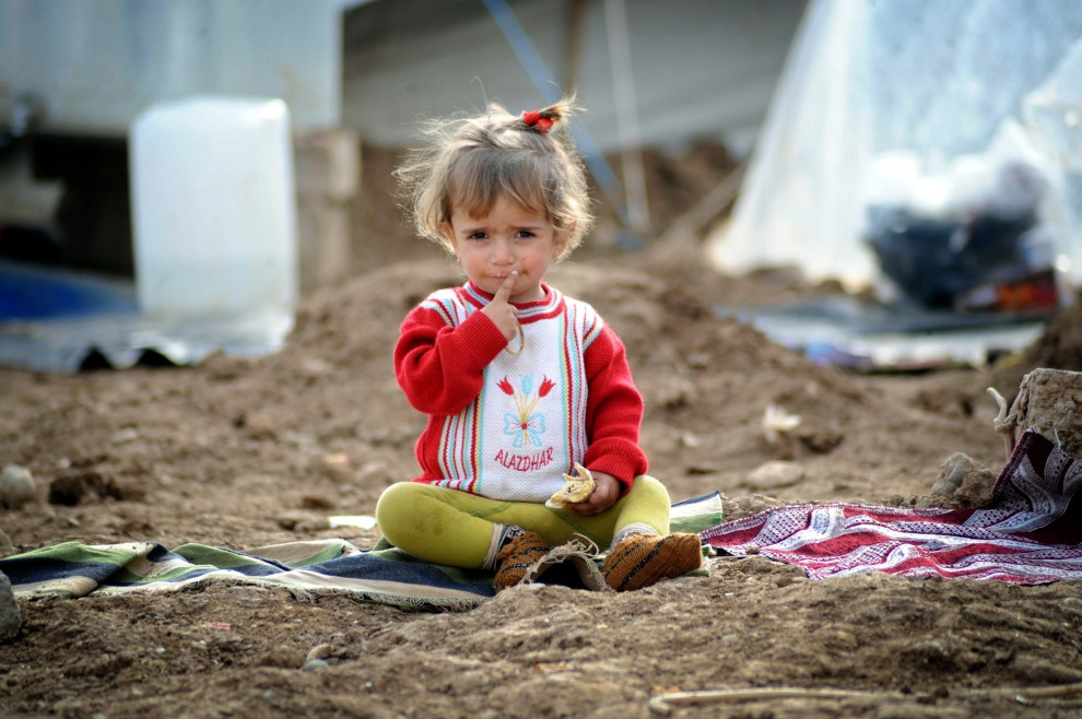 Anadolu Agency took photos of Syrian children who are desperately struggling against cold weather conditions and diseases in Domiz refugee camp