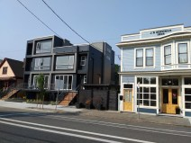 Two different conceptions of urban beauty: a century-old building sits side-by-side with a just-completed condominium. The priorities of each building can practically be read in their architecture (notice the elevated entrance to the new condo, and its designed accommodation of automobile ownership).