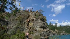 Group on cliff from below.