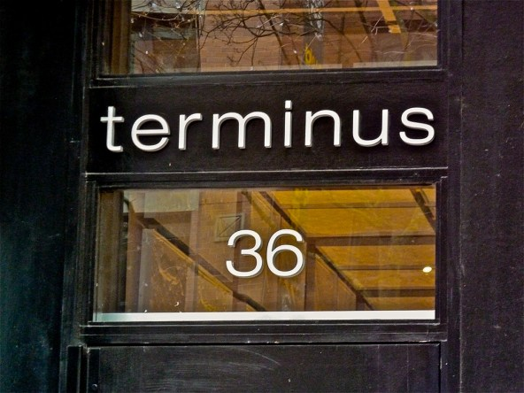 Terminus branded sign with street address that faces onto Water Street in Gastown.