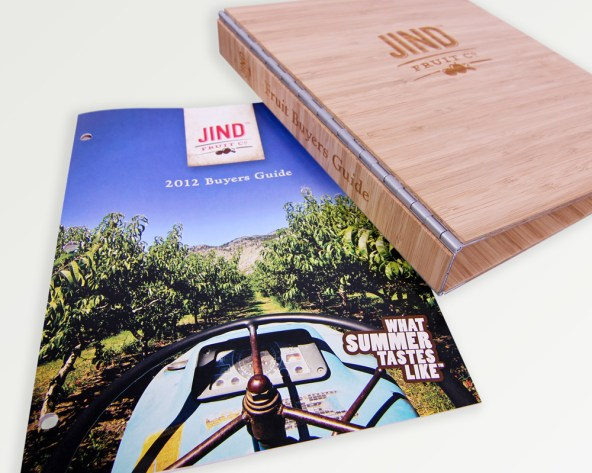 The custom made bamboo binder shown with the cover of the buyer's guide.