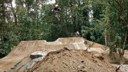 Luke airing the middle line during the dirt jumps construction.